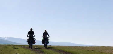 HIT THE ROAD: Start preparing by learning how much bike touring costs and how you can keep your budget low.